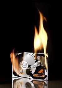 A hard drive surrounded by flames ©Depositphotos/Klanneke