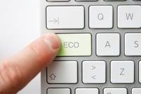 Man pressing eco button on keyboard ©Depositphotos/leeser